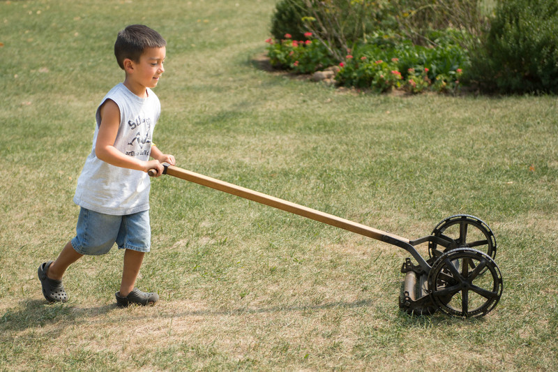 A young visitor tried his hand at mowing the lawn at the Koepsell farm.