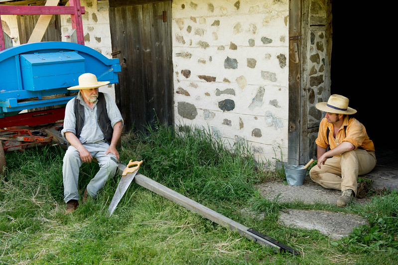 Two farmers take a break when working at the Koepsell farm in the German area.