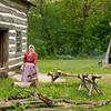 An interpreter splits wood for kindling at the Fossebrekke farm in the Norwegian area.