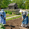 Gardeners prepare tje soil for spring planting at the Koepsell farm in the German area.