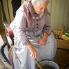 An interpreter makes soap at Mary Hafford House in Crossroads Village