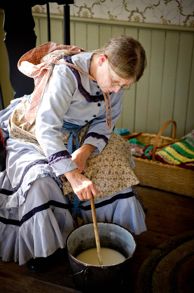 An interpreter in the Mary Hafford house makes soap.