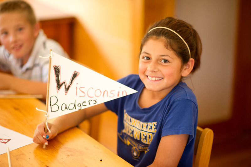 Students on a field trip to Old World Wisconsin make pennants