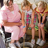 A visitor and her grandchildren making soap at Mary Hafford House