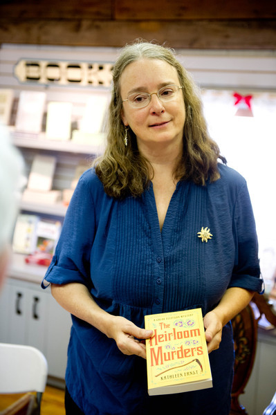"Kathleen Ernst, author of ""Murder at Old World"" and ""Heirloom Murders,"" at a book signing event at the gift shop."