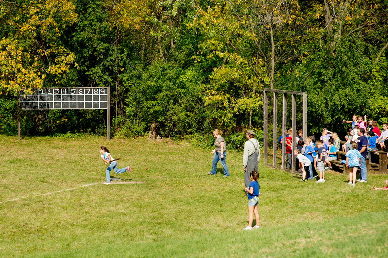 "Children on a field trip at Old World Wisconsin play ""base ball"" following 19th century rules"