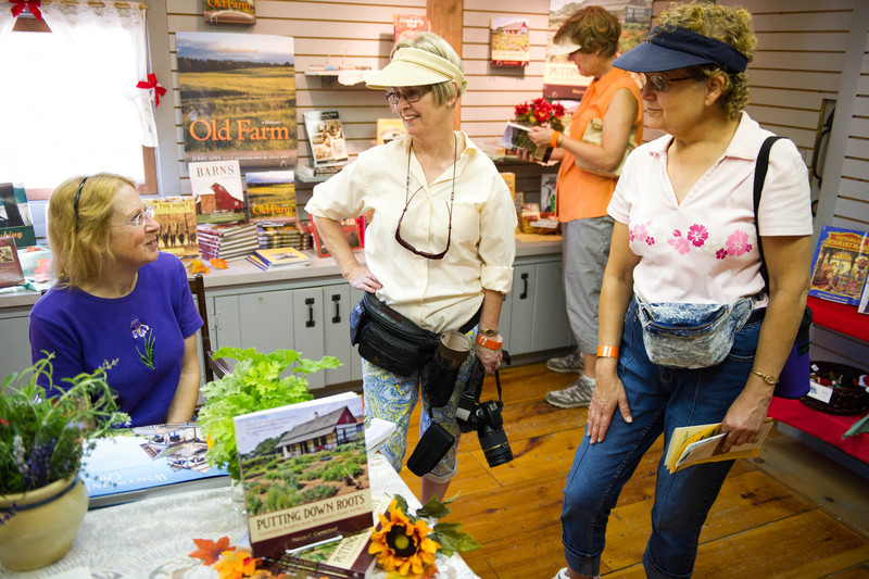 Marcia Carmichael, Old World's historical gardener, chats with vistors during a book signing in the gift shop