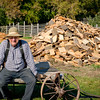 An historic farmer who worked on the steam powered sawmill during the Autumn on the Farms special event, takes a break