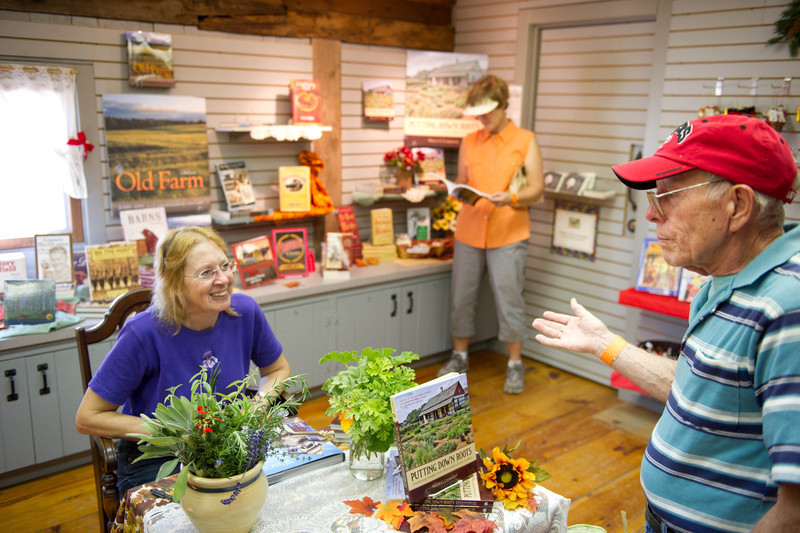 Marcia Carmichael, Old World's historical gardener, chats with a vistor during a book signing in the gift shop