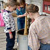 Young visitors at the German Schulz farm help an interpreter make sauerkraut at the annual Autumn on the Farms event in October.