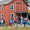 During the 2008 Autumn on the Farms special event visitors peer in the windows of the Peterson wagon shop in Crossroads Village to see a skit taking place about the 1871 Peshtigo fire that killed thousands of Wisconsin residents who lived in or near the small town of Peshtigo in northern Wisconsin.