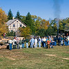 Visitors watch the portable steam engine driven sawmill at the annual Autumn on the Farms special event in October.
