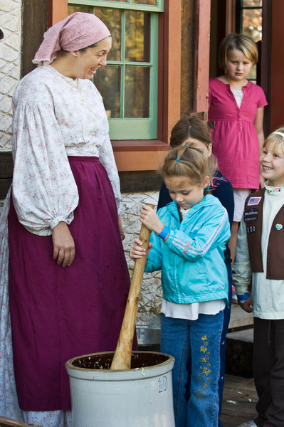 Young visitors line up to take a turn at making sauerkraut at the 1860 German Schulz farm during Autumn on the Farms, a special event held each October.