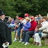 "The ""barrister"" (now known as umpire) explains the rules of vintage base ball to fans before the game begins."