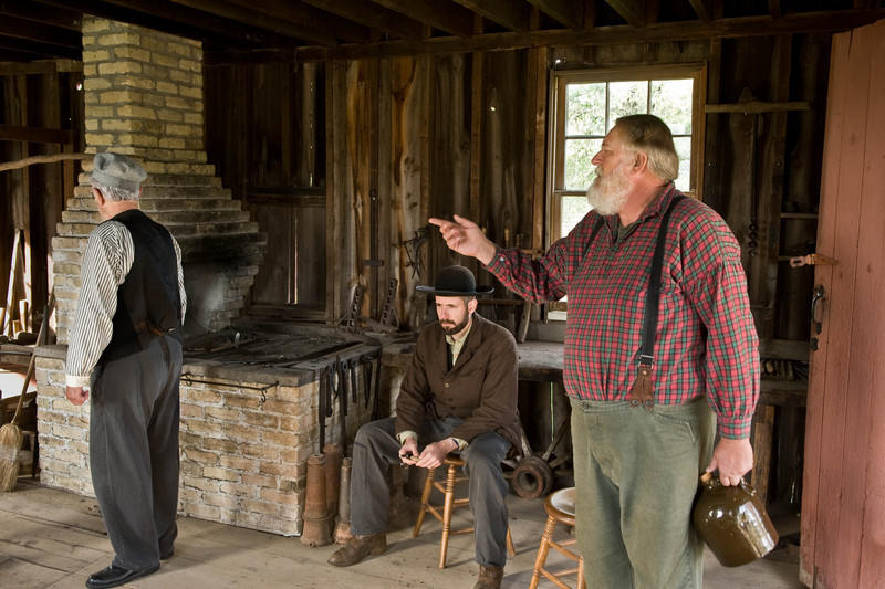 Actors in a skit at the Autumn on the Farms special event in 2008 discuss the Peshtigo fire that killed thousands in 1871, the same night as the famous Chicago fire.  The skit was held in the Peterson wagon shop in Crossroads Village and was open to all who attended Autumn on the Farms.