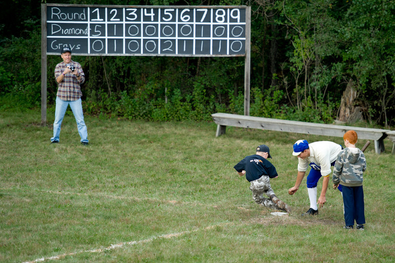 "After each vintage base ball game young fans are invited to come down on the field and try their skills with the ""real"" players."