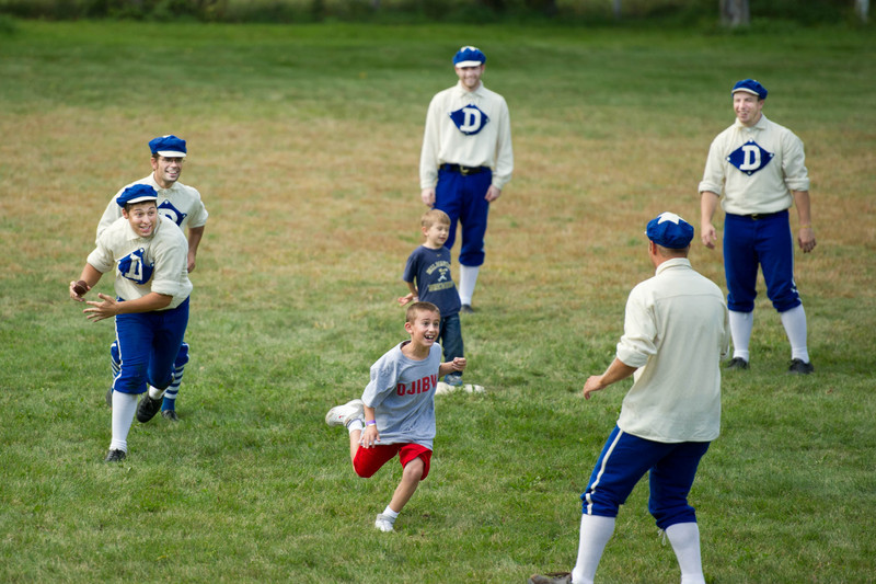 """After each vintage base ball game young fans are invited to come down on the field and try their skills with the """"real"""" players."""