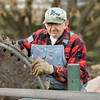 The sawmill operater pauses while sharpening  his saw during Autumn on the Farms.