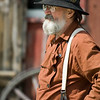 A Civil War reenactor relaxes outside the Grotelueschen Blacksmith Shop.