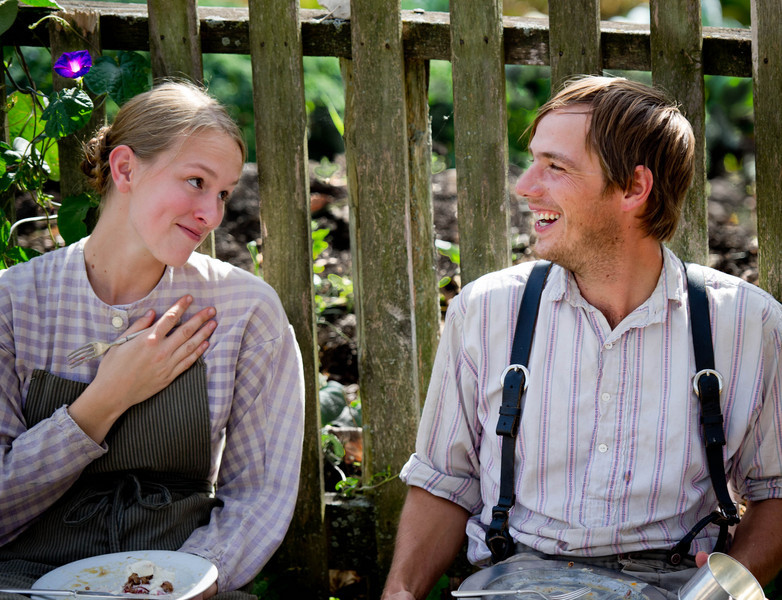 Heather (interpreter) and Ben (historic farmer) enjoy each other's company at the farm dinner for volunteers and staff during the annual Autumn on the Farms event.
