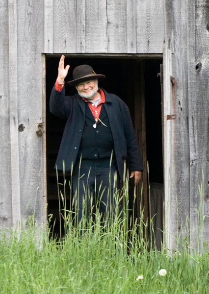 Ken, an interpreter, greets visitors as he emerges from the Grube barn at the 1860 Schulz (German) farm.