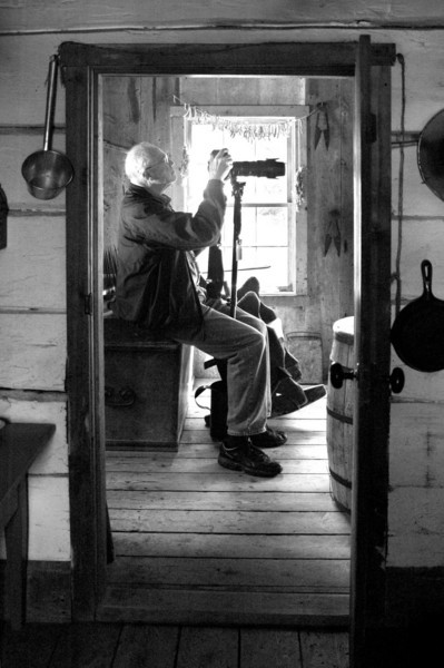 Loyd Heath in the kitchen of the 1897 Rankinen (Finnish) farmhouse.  Photo by Bruce Batten.