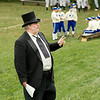 Lee, an interpreter who also serves as barrister (umpire) at vintage base ball games (yes, it used to be 2 words) , explains the rules of old time base ball to fans before a game.  The players in blue and white are from the Eagle Diamonds, Old World's own base ball team.