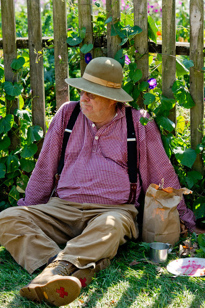 Tony, historic farmer, relaxes after enjoying dinner at the farm dinner for volunteers and staff at the annual Autumn on the Farms event.