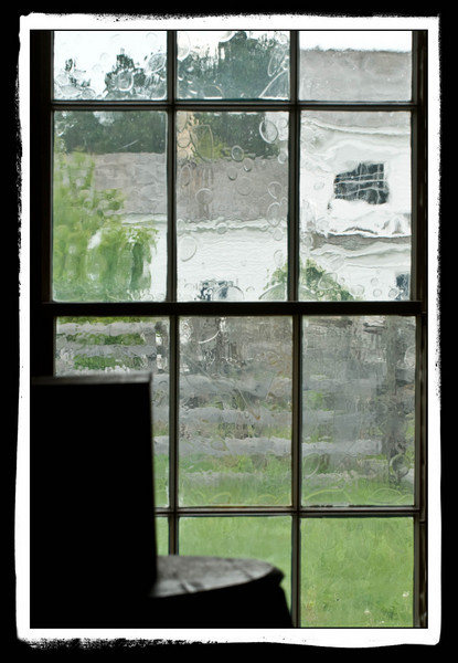 The Sanford farmhouse in Crossroads Village as seen through a window in the Thomas general store.