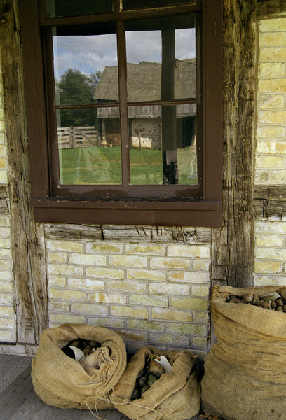 A window in the Koepsell farmhouse contains a reflection of the stable behind the house.