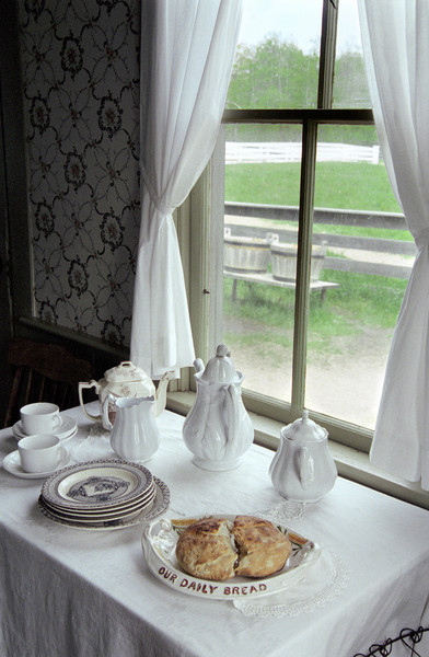 Mary Hafford's cherished tea set bathed in light from a window.