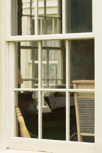 Looking through kitchen windows in the 1875 Benson house in Crossroads Village.