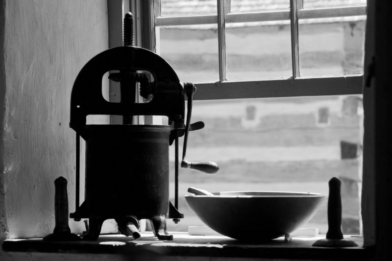 A sausage press is seen in a window in the Schottler farm summer kitchen.