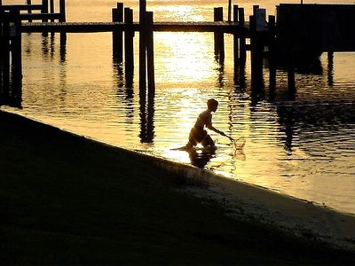 This was taken in Orange Beach, Alabama outside our condo.  The subject is Matthew Holleman, son of Lisa and Tim Holleman.   It was taken about 7 years ago I think.