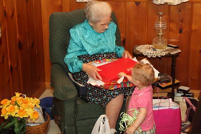 Hannah helps open presents