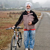 12-03-08 Biker on the Bike Path<br /> <br /> Joan and I see this man on the bike path often. Today, he stopped me and asked me to take his picture. I'll print it out and deliver it to him at the 7-Eleven where he works nights.