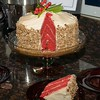 "12-06-08 <a href=""http://jmearns.smugmug.com/gallery/6766034_JExUZ#432106371_Y8ZGa"">Xmas Party</a> - Red Velvet Cake  From Paula Dean's grandmother's recipe <a href=""http://www.foodnetwork.com/recipes/paula-deen/grandmother-pauls-red-velvet-cake-recipe/index.html"">here</a>.  The frosting is NOT from this recipe. It's just a regular cream cheese frosting, with chopped pecans pressed into the sides.  YUMMY."