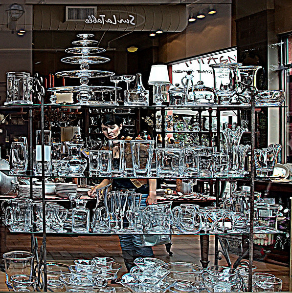 10-4-08 Simon Pearce - my favorite glass. I have lots of it - received as gifts over the years. This was just a great display in one of the local store windows - the beautiful woman shopping was a total accident - wasn't even aware that she was in the frame until I saw it onscreen. <br /> <br /> Obviously highly post processed - mostly by using exagerated sharpening settings.  I like it. What do you think?