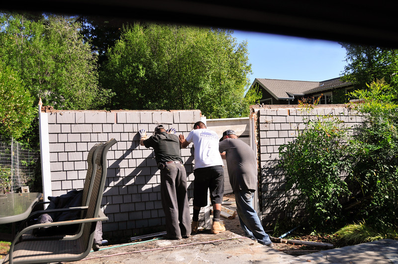 I think this is when they realized this was a solid wooden wall - a log cabin actually. They're trying to push it over - no go. They decided to call it a day and tackle it tomorrow.