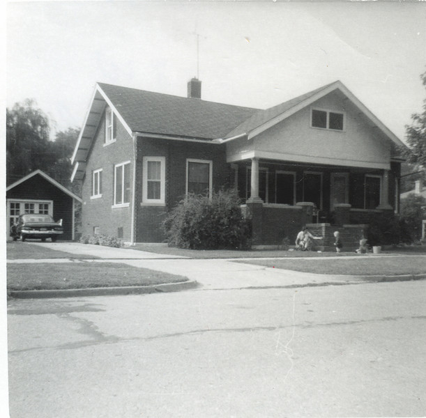228 w Franklin, we lived here from 1961-1963.At present, this house is still standing though many of it's neighbors are teardowns.That's me and Rich with my mom out front.&nbspHow bout those fins on that Plymouth!