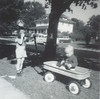 This I believe is on Franklin st, looking west. That's Rich pulling me in the wagon.  This would be about 1962.