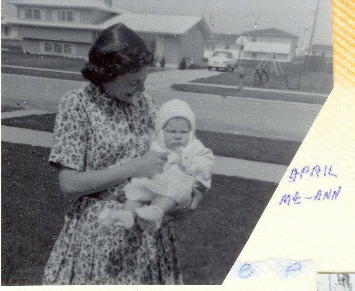 In front of 308 Tupelo looking north, slightly northwest across the street, 1965.  My mom with Ann