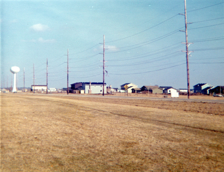Behind 308 Tupelo looking southeast at 75th st; the water tower is the one at Clyde dr  near Lincoln Jr. High