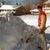 We had another big blizzard besides Jan 1967--this one was Jan 1979.  This is Bill out fron of 308 Tupelo.  Notice the snow on the roof across the street and the level of snow near the garage across the street.