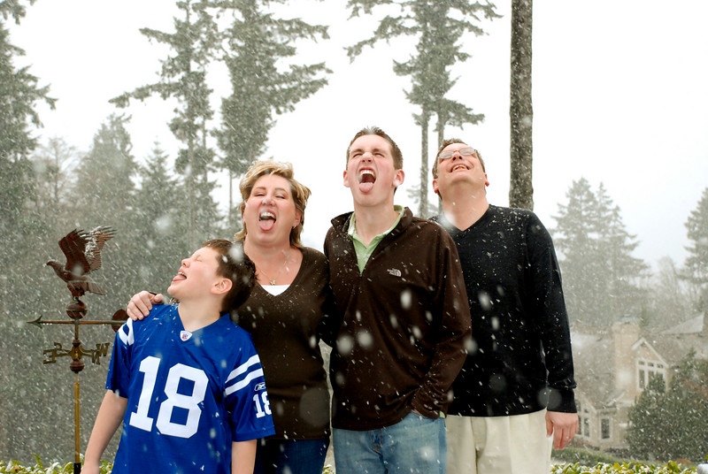The Pitts family catches snow.