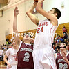 """Moriah's Adam Jaquish (24) goes for a shot over Chateaugay's Chandler LaPlante (2) and Jamie Rabideau (22) Wednesday March 2. 2016 during the Cladd D NYS Regional Semi-Final game at SUNY Plattsburgh Fieldhouse.<br /> Bouns at  <a href=""""http://www.pressrepublican.com"""">http://www.pressrepublican.com</a>. (ROB FOUNTAIN/STAFF PHOTO"""