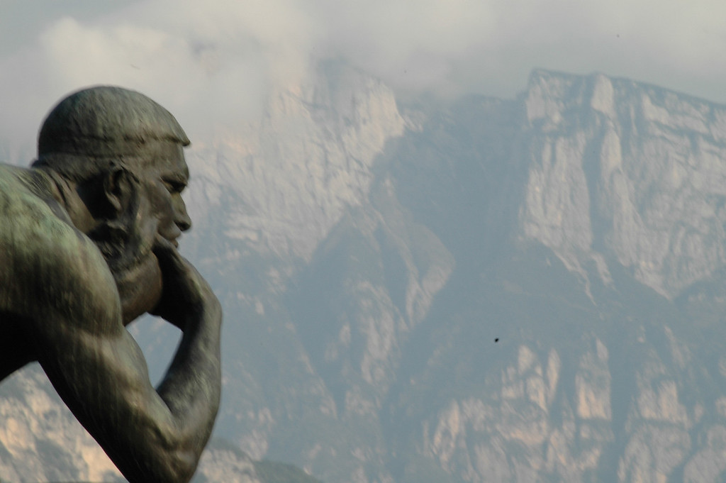 Thinking statue in Trento - perhaps he\'s dreading riding a bike into the mountains?