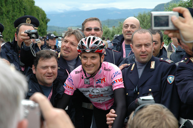 Ivan Basso, surrounded by the national police who control the roads for the race.