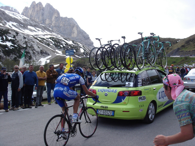 The pros use the team cars to draft.  Its against the rules, but isn\'t enforced for the \'water carriers\'.