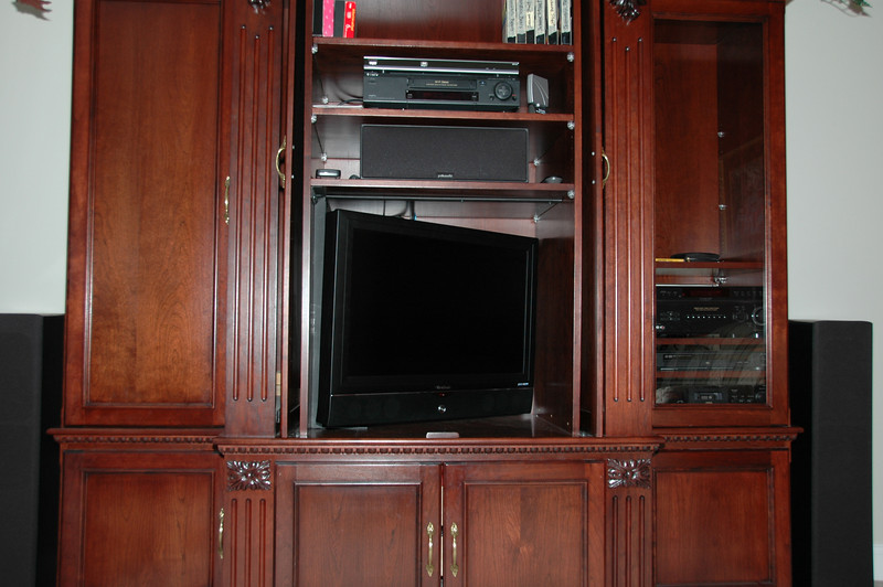 TV swiveled in cabinet to store
